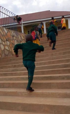 Kampala CPC children running up stairs